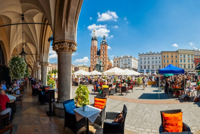 Krakow full of tourists having a coffee break under the archs of the Cloth Hall